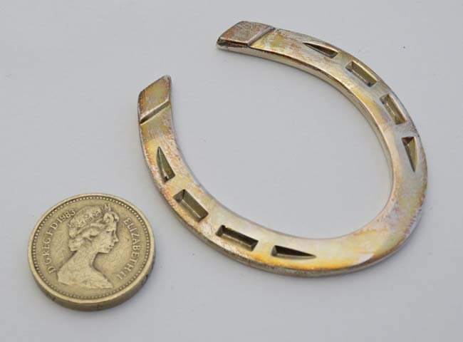 A silver miniature model of a horseshoe. Hallmarked - 2