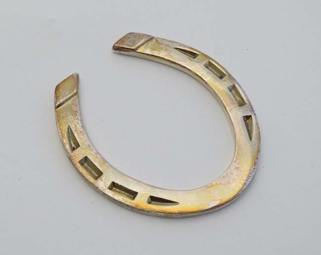 A silver miniature model of a horseshoe. Hallmarked - 4