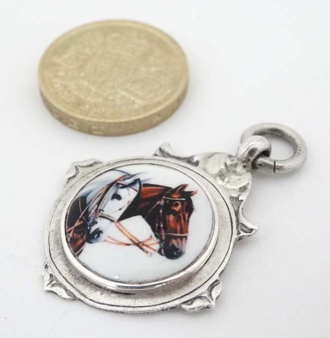 A hallmarked silver fob with later applied ceramic - 3