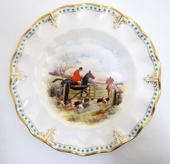 A Royal Crown Derby hand painted hunting scene fluted