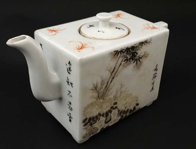 A Chinese square form teapot, decorated to sides with