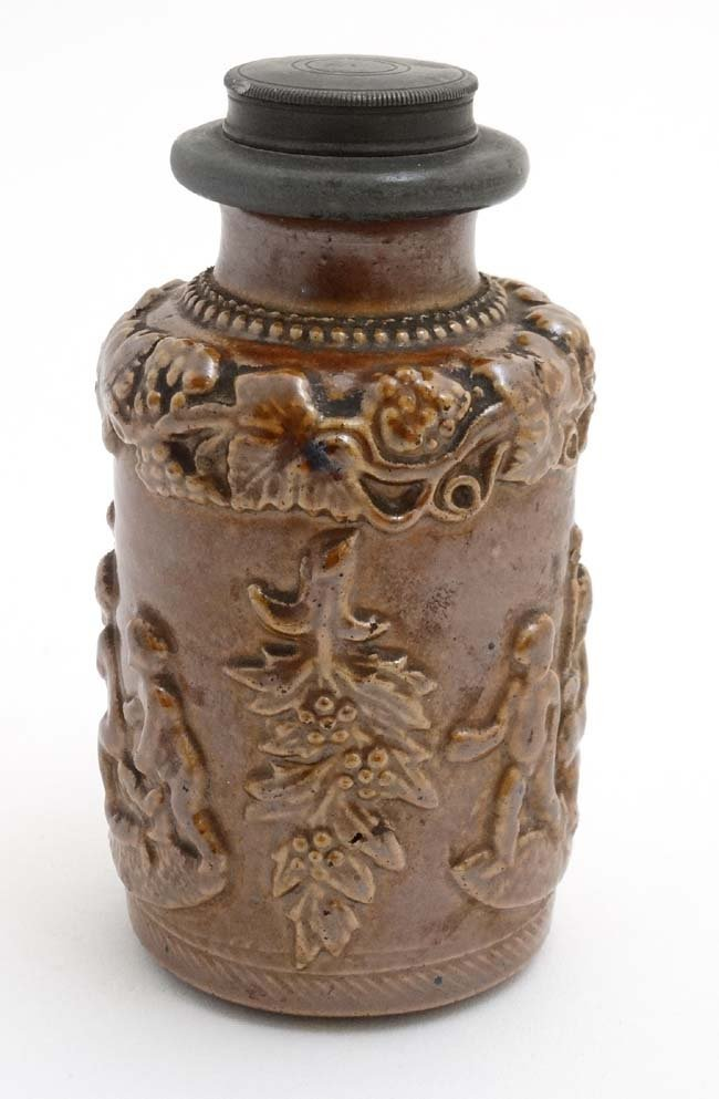 A Stoneware flask decorated with image of a young