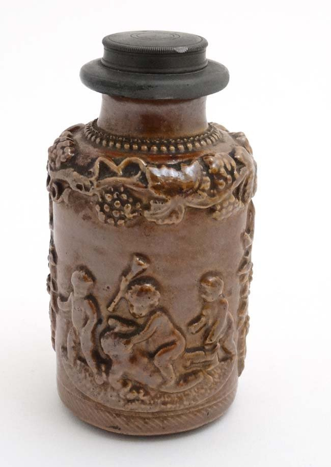 A Stoneware flask decorated with image of a young - 3