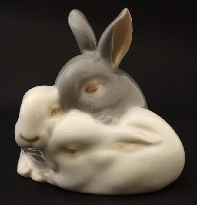 A Royal Copenhagen figure group formed as three rabbits