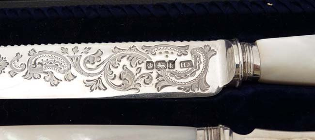 A cased silver serving knife and fork hallmarked - 4