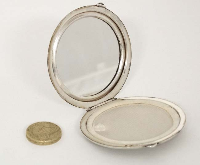 A silver powder compact with engine turned decoration. - 4