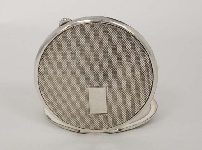 A silver powder compact with engine turned decoration. - 6