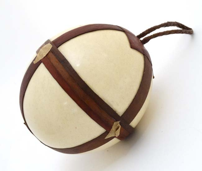 A c.1900  Leather mounted ostrich egg typically from