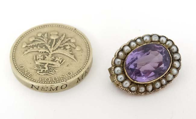 A gilt metal brooch set with central amethyst bordered - 4