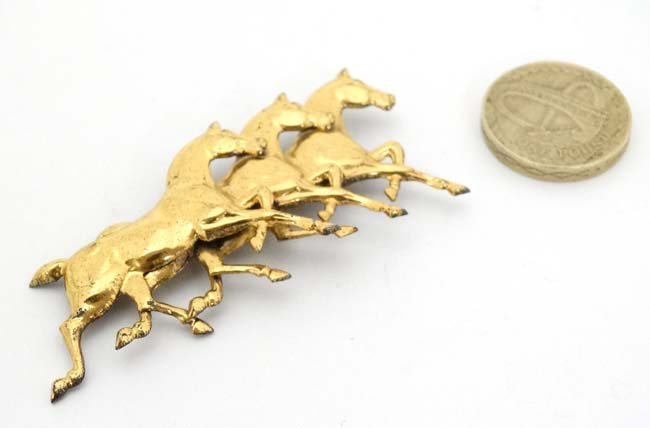 A silver gilt brooch formed as 3 horses. Marked - 3