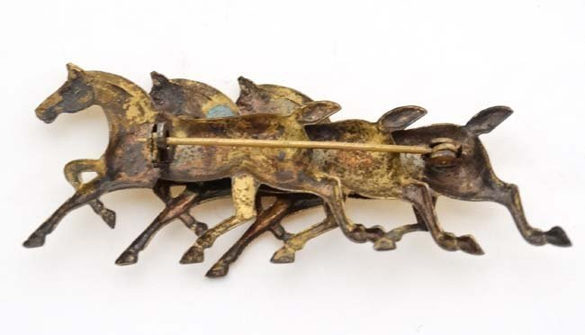 A silver gilt brooch formed as 3 horses. Marked - 4