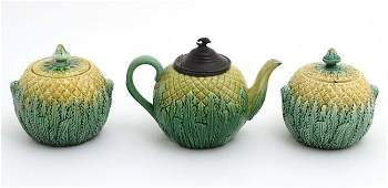 A Majolica pewter lidded pineapple teapot decorated in