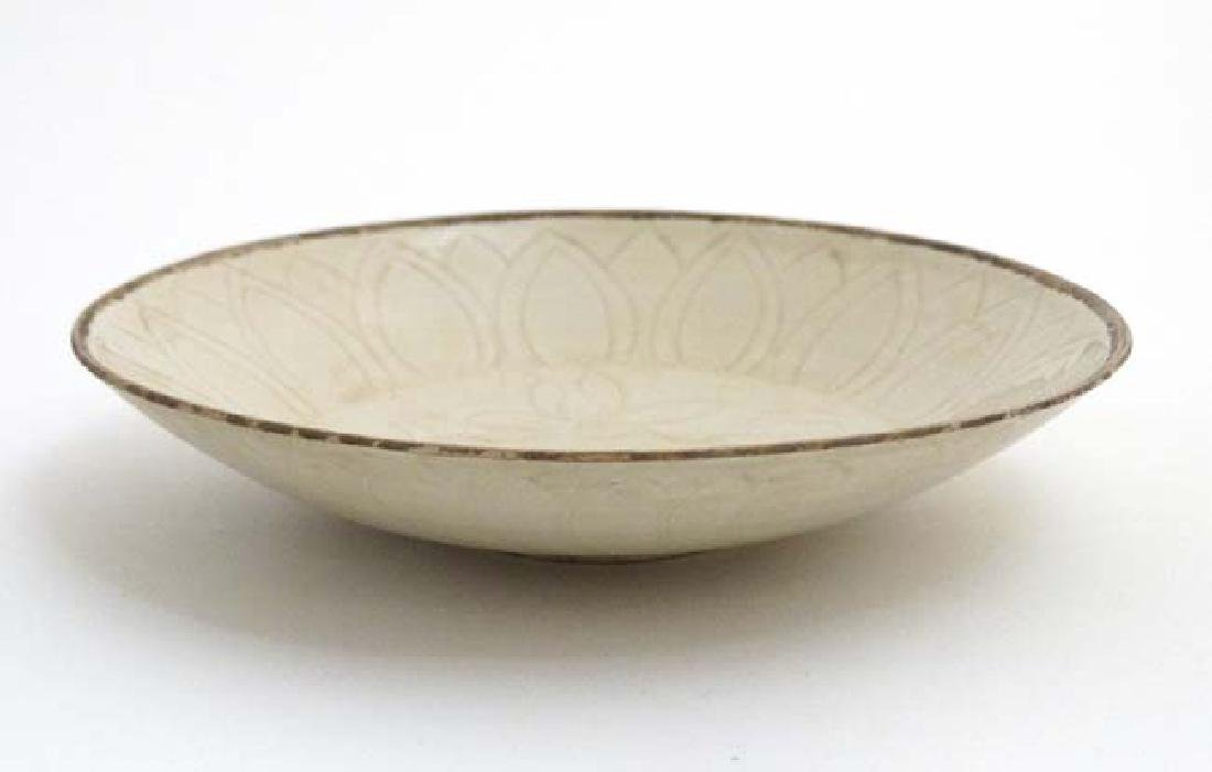 A Chinese Ding ware style bowl , having stylised floral