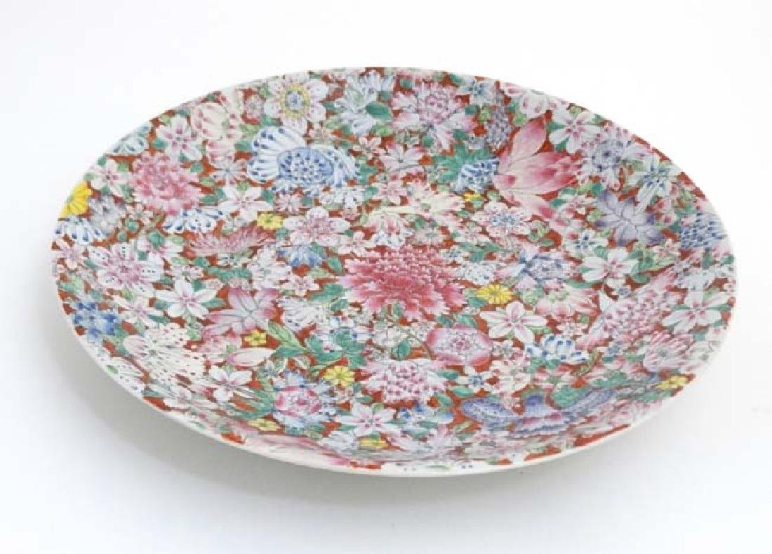 A Large Chinese millefiori charger, decorated in