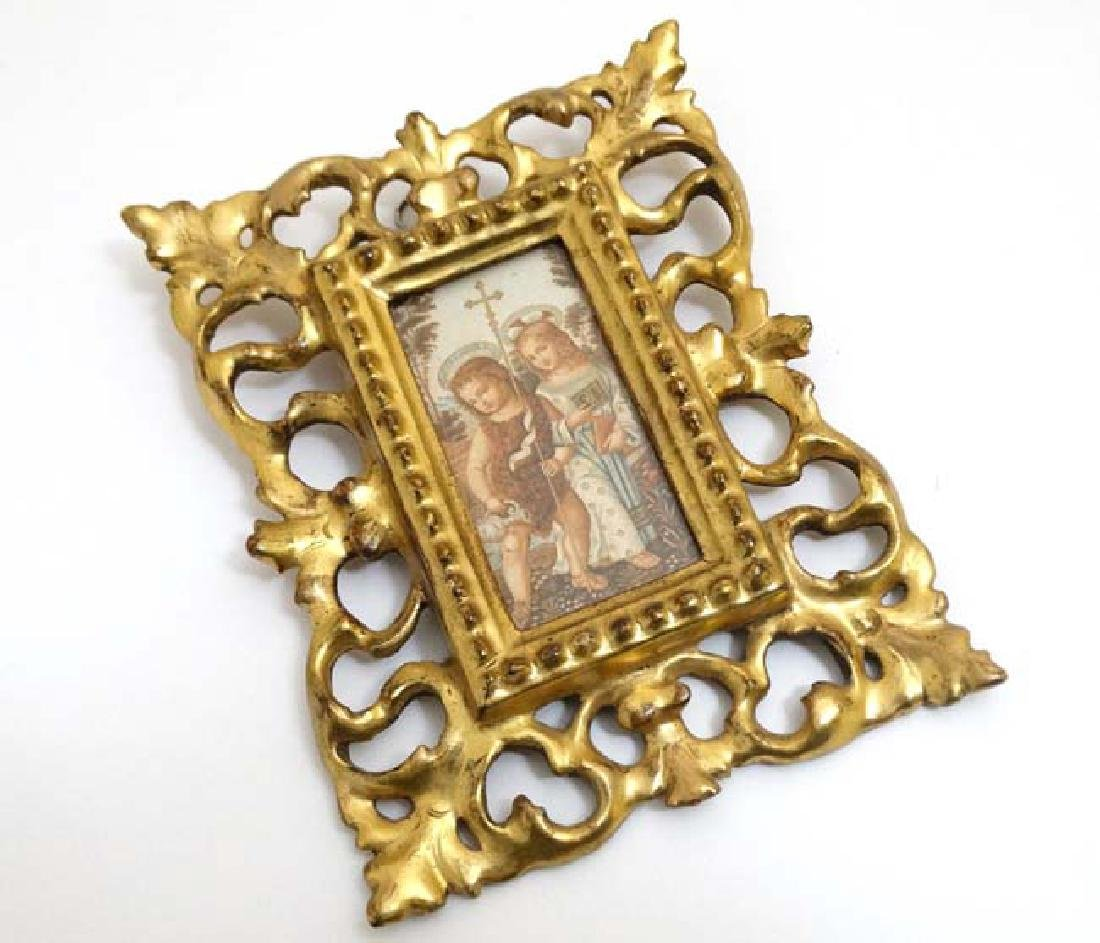 A Victorian gilded and carved wooden Florentine frame,