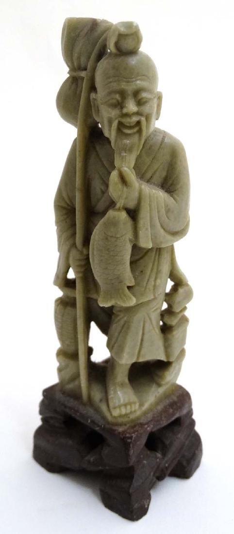 A jadeite carved Oriental figure of a fisherman