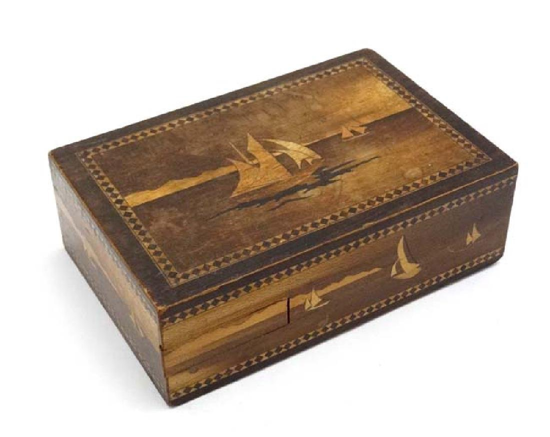An Arts and crafts marquetry inlaid puzzle box with