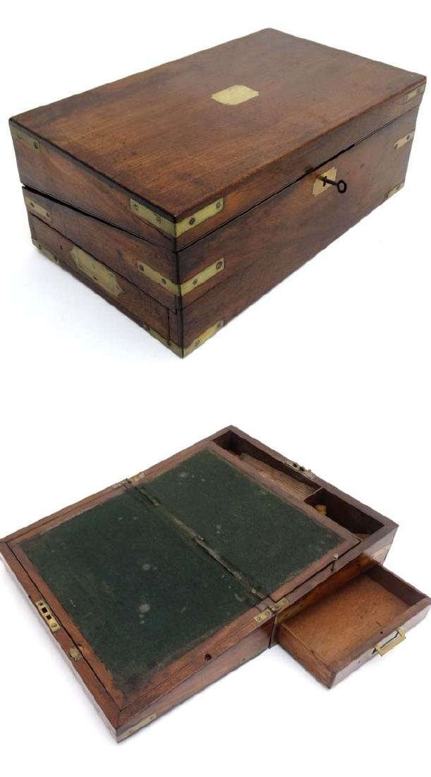 A 19thC military mahogany brass bound writing slope