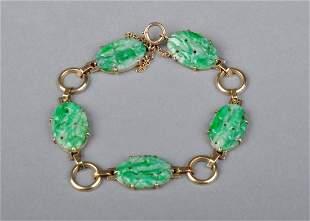 A Carved 14 K Gold Green Jadeite bracelet, 19th century