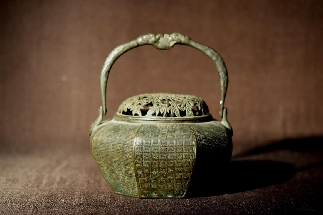 Asian Bronze Hand Warmer with Floral Motif Cover