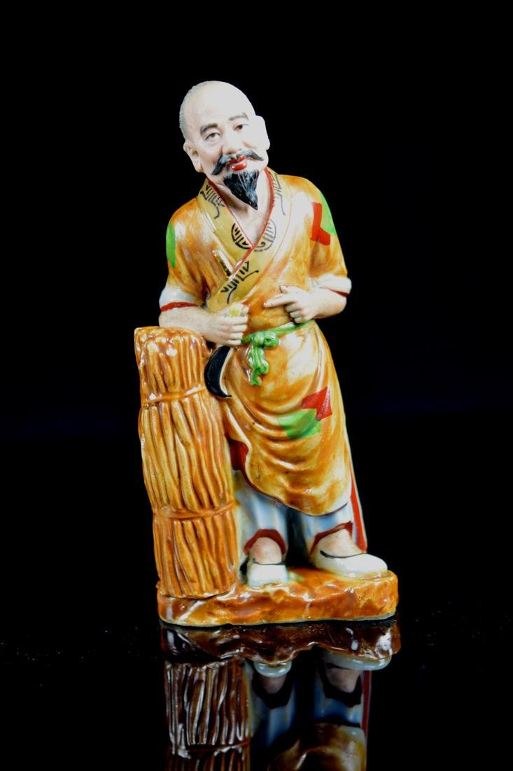 Chinese Porcelain Model of a Fisherman - Signed