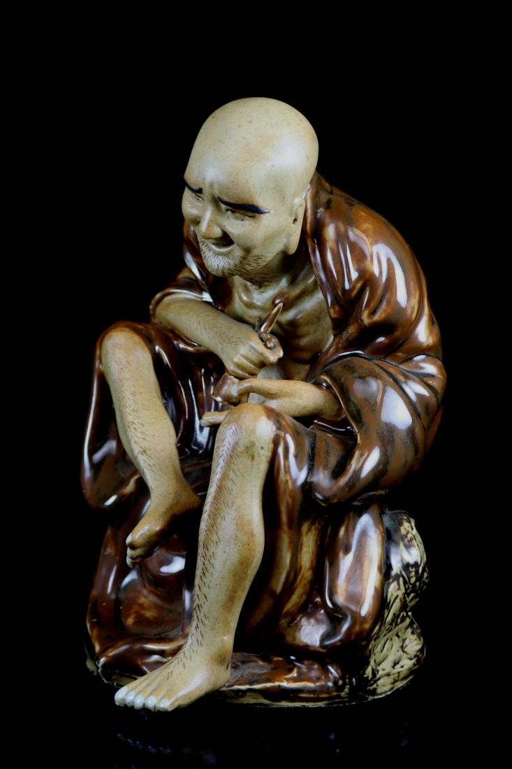 Chinese Porcelain Figurine of a Lohan - 4