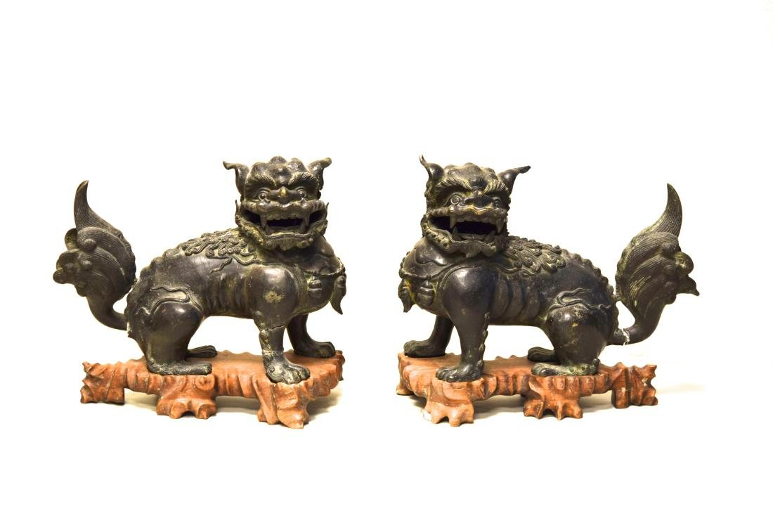 Pair Chinese Ming Bronze Foolions with Rosewood Base