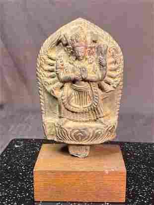 Tibetan Carved Stone Buddha on Wood Stand