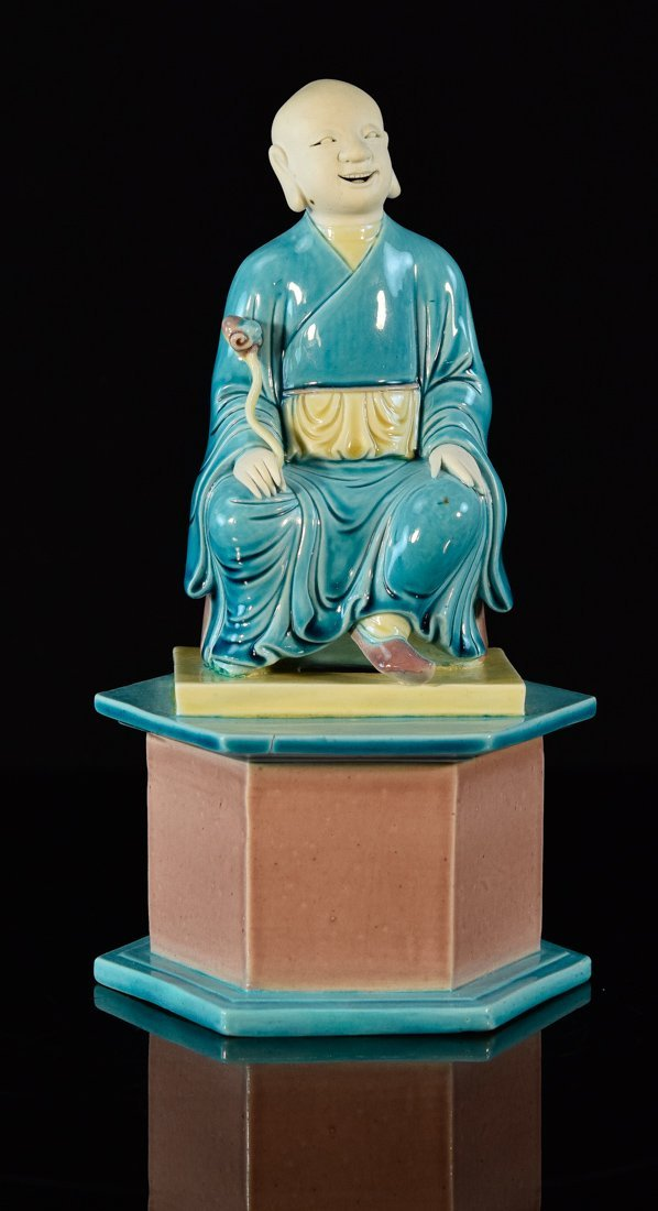 Chinese Porcelain Model of a Seated Lohan on Base