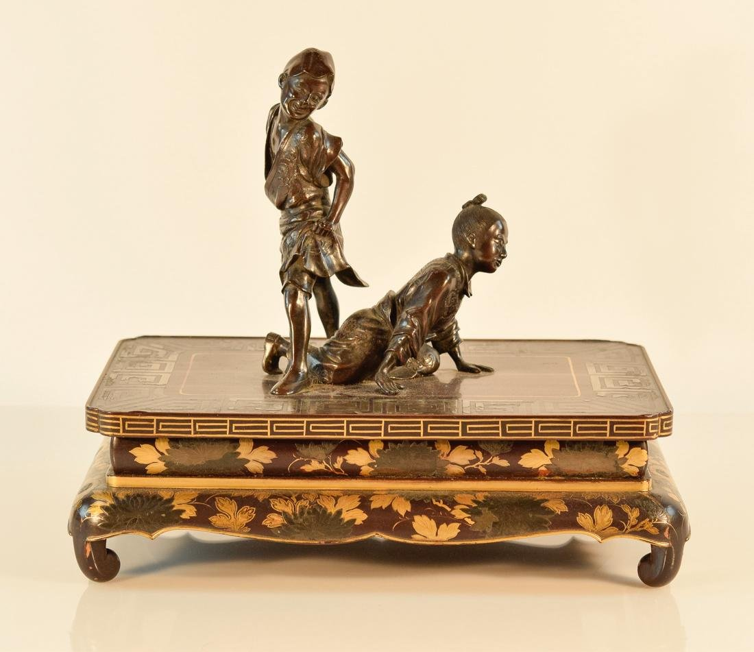 Japanese Bronze Figurine Group on Lacquer Stand