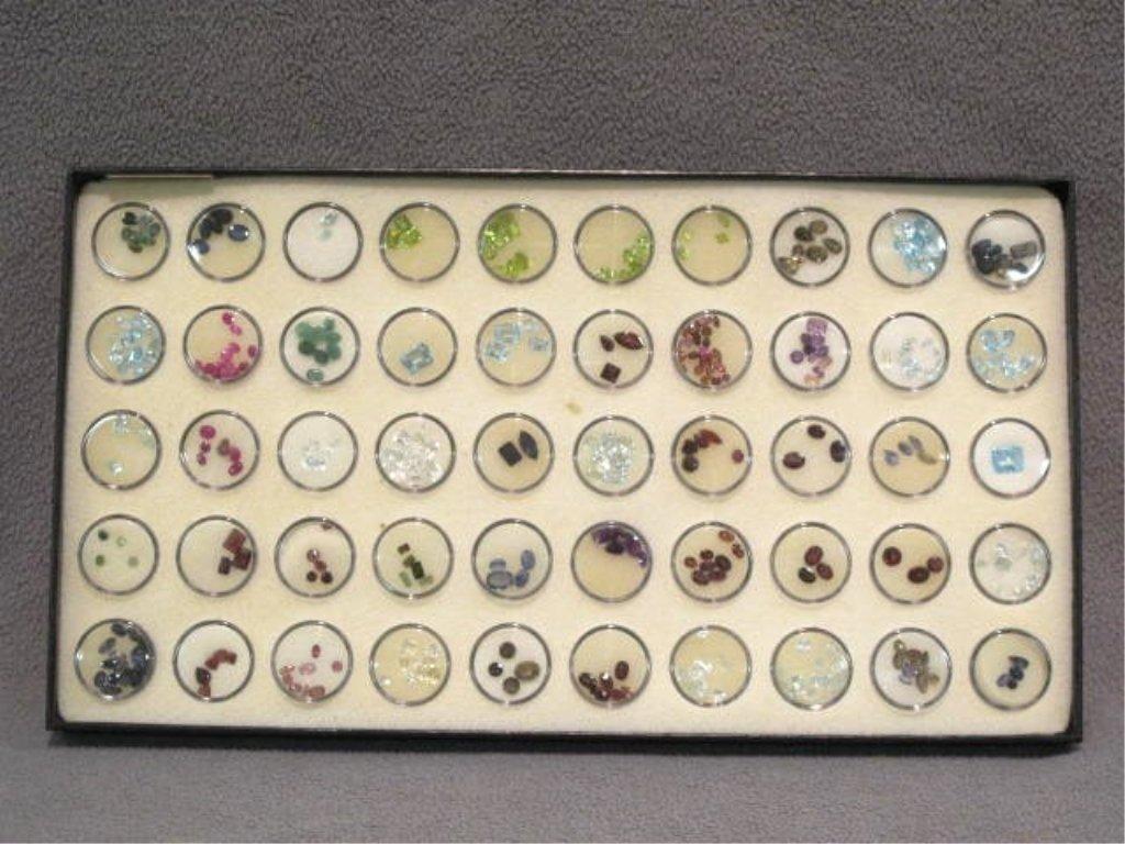 338 unset precious and semi-precious cut gemstones