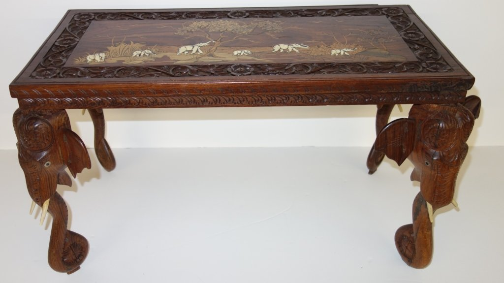 Inlaid table with elephant legs
