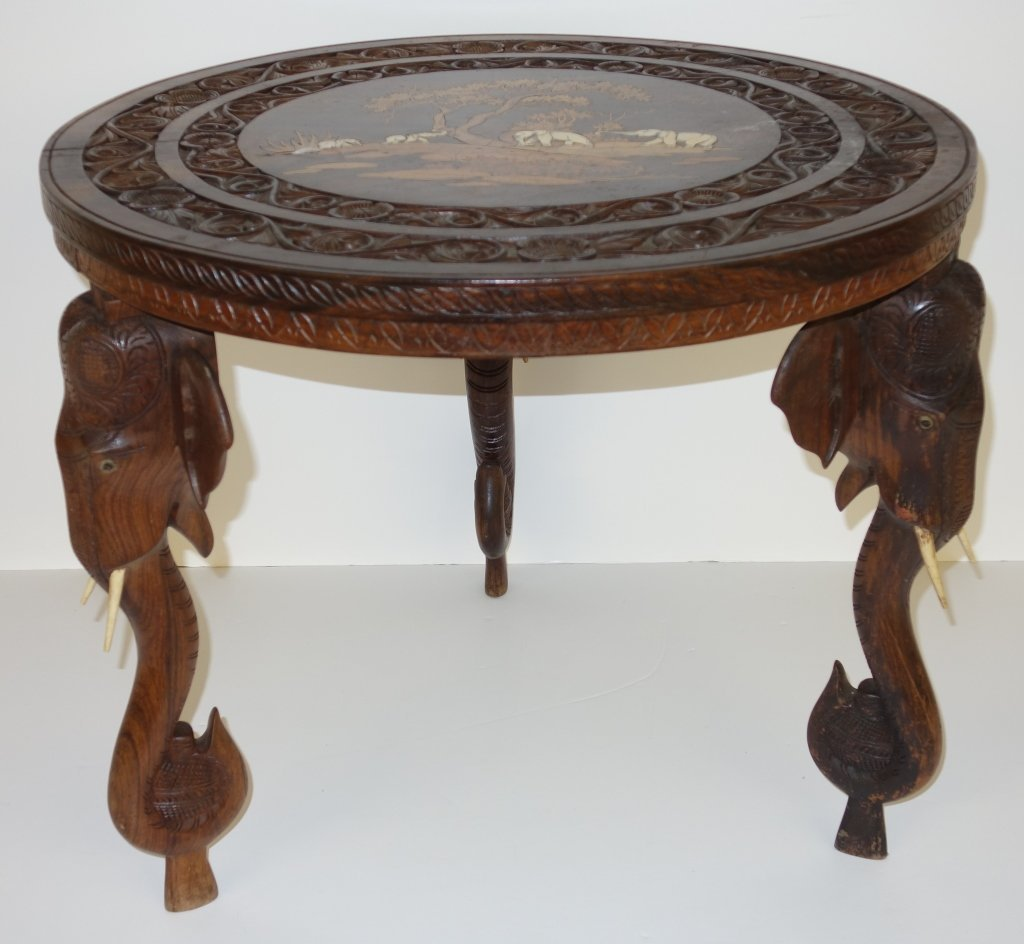 Inlaid round table with elephant legs