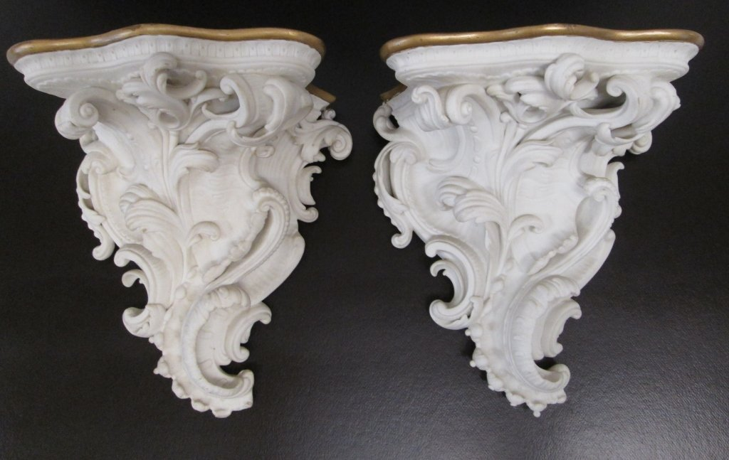 Pair of ornate porcelain shelves