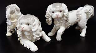 Pair of porcelain dogs by Jeanne Reeds