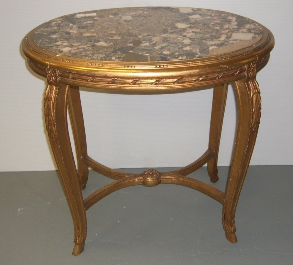 Marble top oval French gilt wood carved table