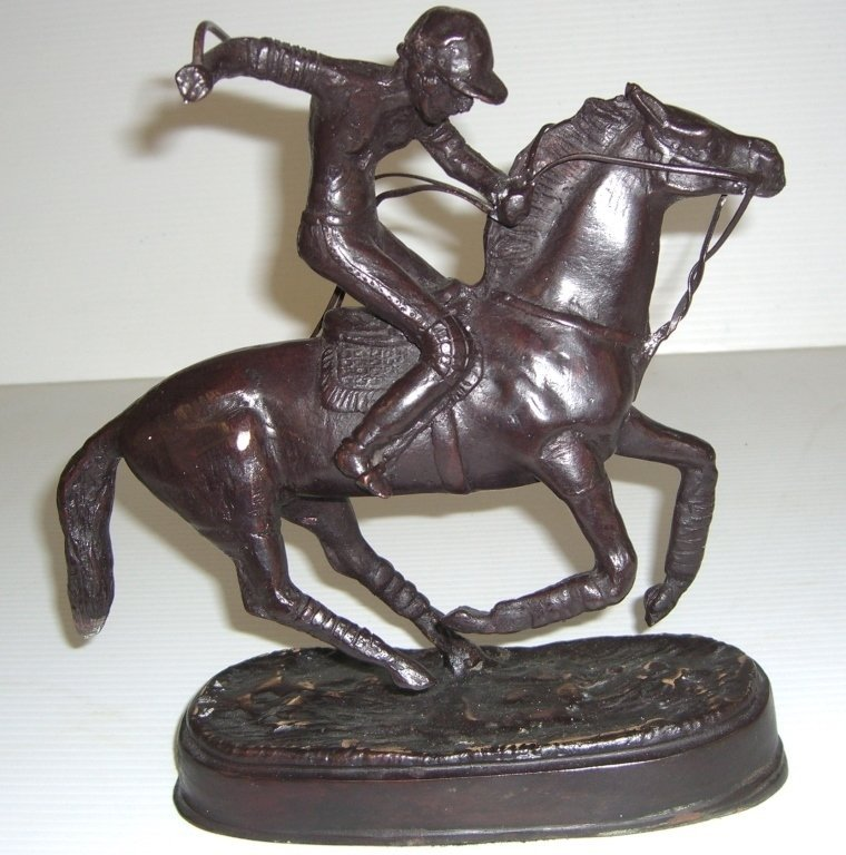 Metal statue of Polo player on horse