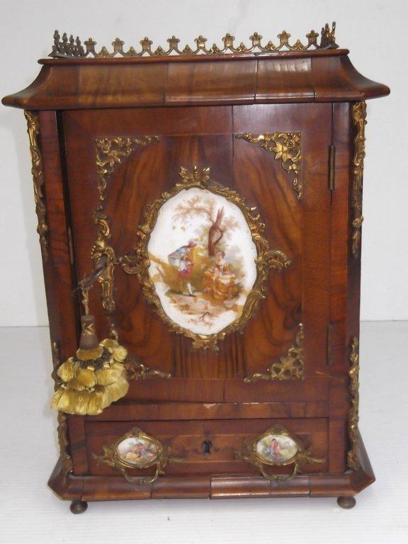 Porcelain mounted French locking miniature cabinet