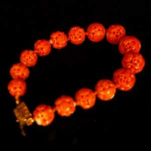 A Qing Dynasty Weidiao Coral Bracelet
