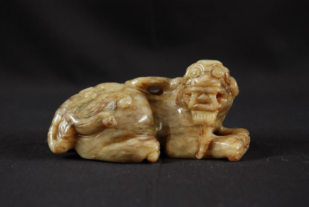15: A GREEN JADE CARVING OF A LION DOG