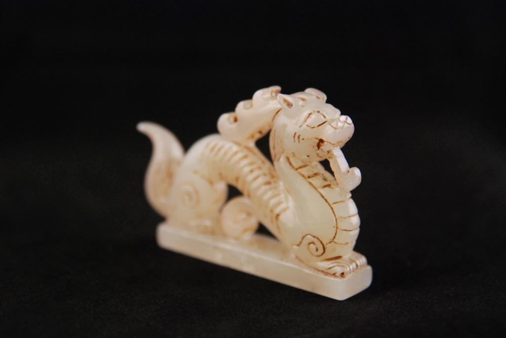 16: A SMALL WHITE MOTTLED JADEITE DRAGON CARVING - 3