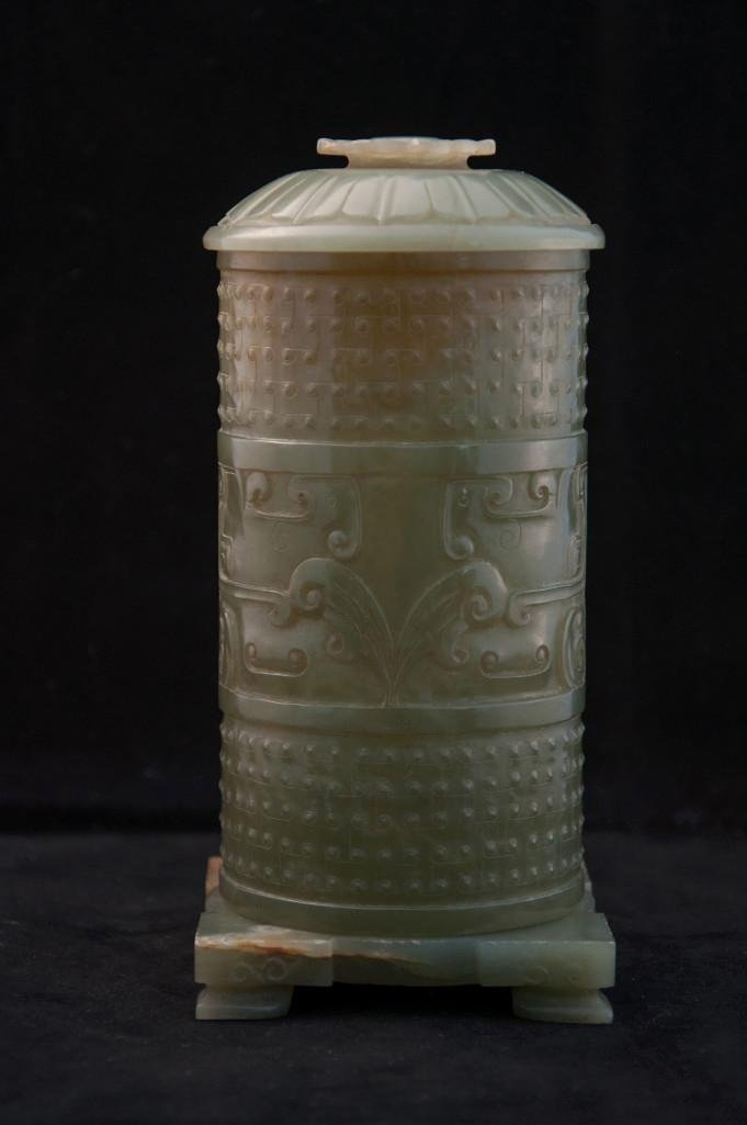 21: A CHINESE CARVED CELADON JADE INCENSE HOLDER WITH L