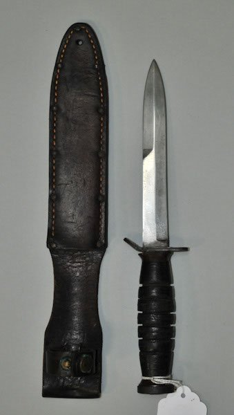 8: WWII US Army fighting knife with leather grip accomp