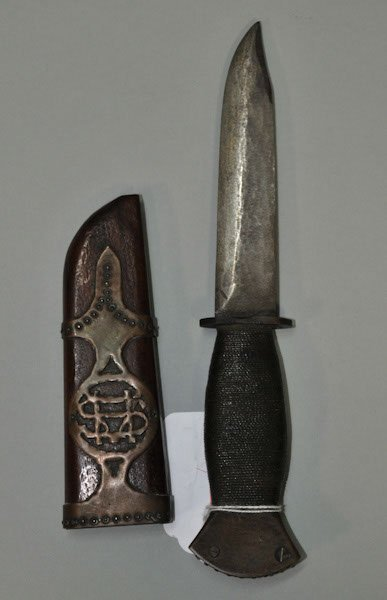 9: WWII soldier-made fighting knife with unique brass r