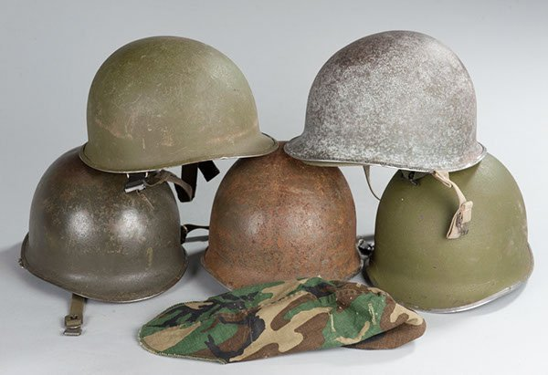 17: Collection of 5 US GI helmets, 2 from WWII, 3 post