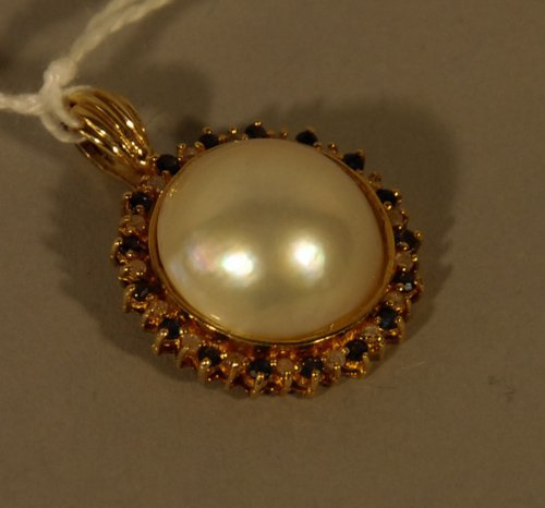 4: A 14K Gold, Mabe Pearl, diamond and Sapphire Pendant