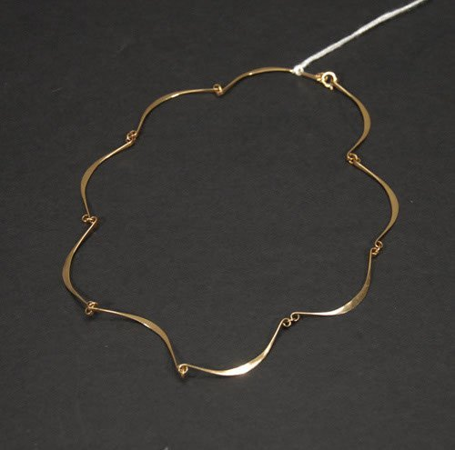 6: 14 Kt. Gold Necklace Marked 14 Kt. to clasp. 3.4 dwt