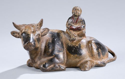 Asian Metal Sculpture of Figure sitting on Bull