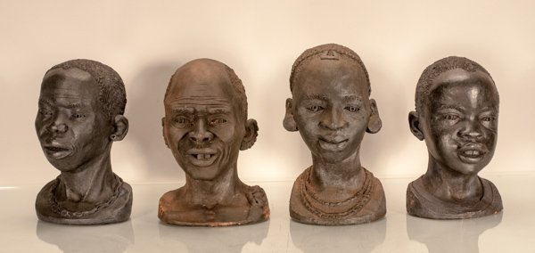 Four Carved Wood African Busts, Two Males and Two