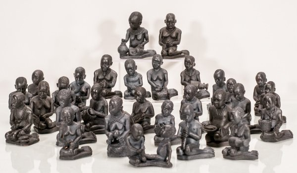 30 Small African Carvings Depicting Everyday Activities